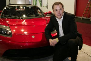 Mr. Elon Musk with the Tesla Roadster